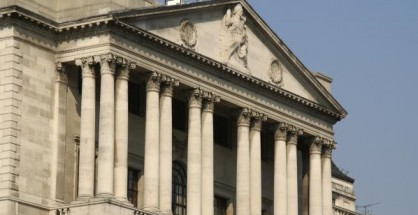 Bank of England holds rates steady at a record low