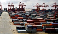 China reports a record surge in exports; policymakers hopeful that global demand will aid the recovery of the country's weak housing market and services sector.